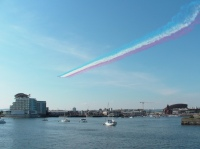 Red Arrows fly over Cardiff Bay