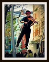 Man Playing Violin in Hayes Cardiff